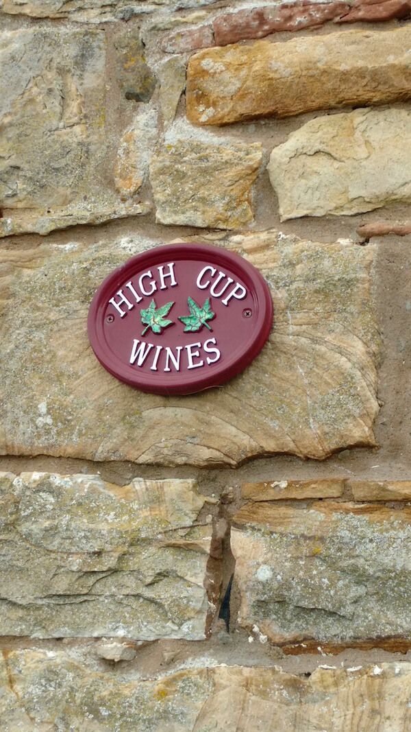 cobbled-wall-with-sign-of-high-cup-wines-cumbria-uk