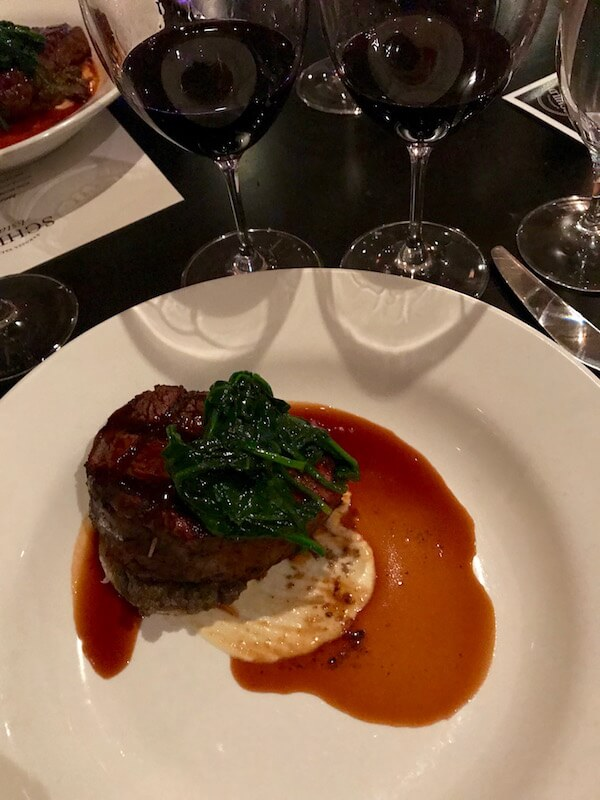Deconstructed Beef Wellington with a Puff Pastry Disc, Wilted Spinach, Mushroom Duxelles & Thyme Jus - Coco's Restaurant