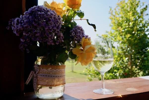 Blue Gables Winery - Glass of Chardonnay & Fresh Flowers