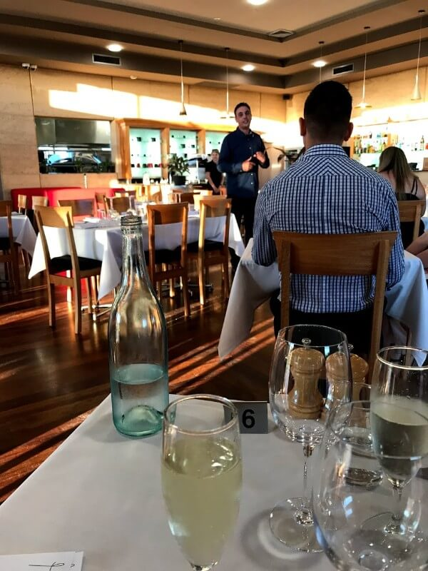 daniel-pinelli-talking-to-the-crowd-before-dinner-at-pinelli-estate-winery-restaurant