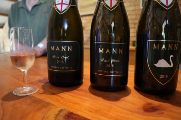 glass-of-mann-rosi-brut-and-three-bottles-at-mann-estate-swan-valley