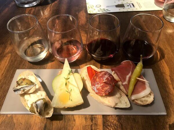 plate-with-four-pintxos-matched-with-four-wines-on-a-wooden-table-at-pandemonium-wine-estate-swan-valley