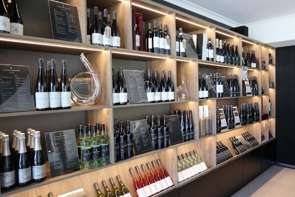 shelves with castelli wine and decanters for sale