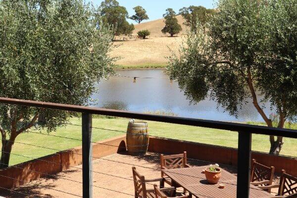 lake and verandah at hackersley estate