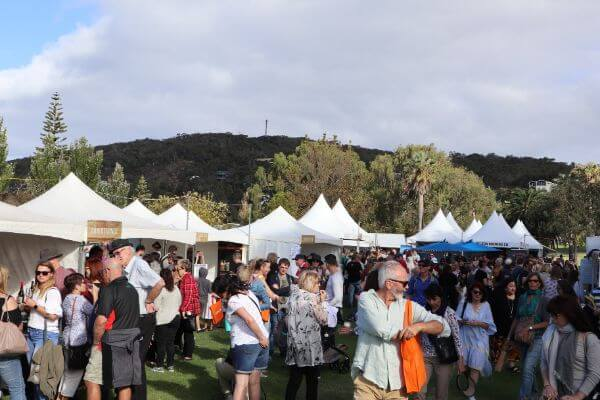 the crowd at the albany wine and food festival with mount clarance in the background