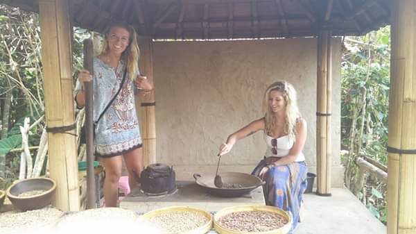 two girls roasting coffee beans