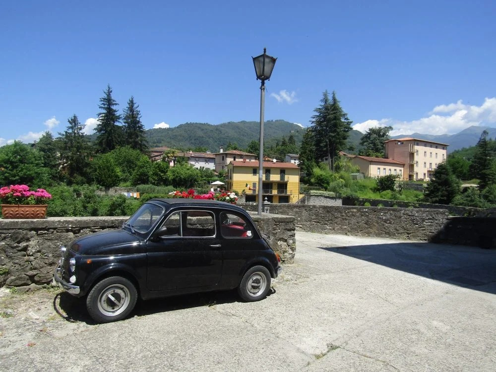 an tiny old car in Barga