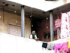 Woman on balcony, India, travel photo, awesome photo