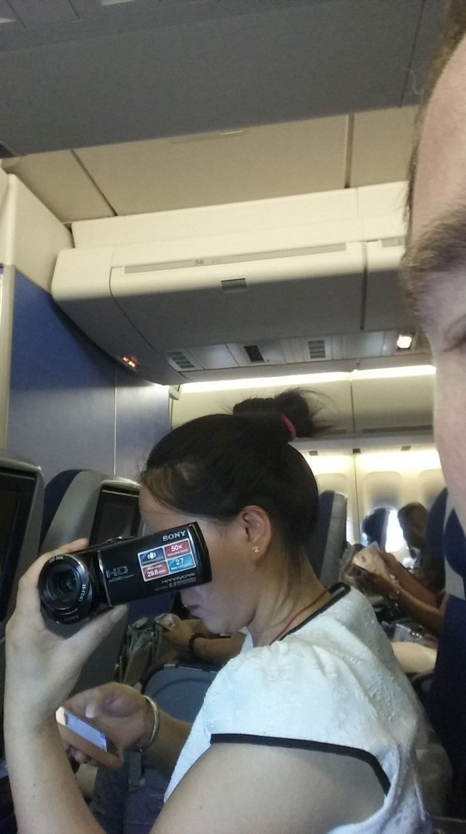 this woman filmed the inside of the plane, leaned over me to film the take off, and landing.