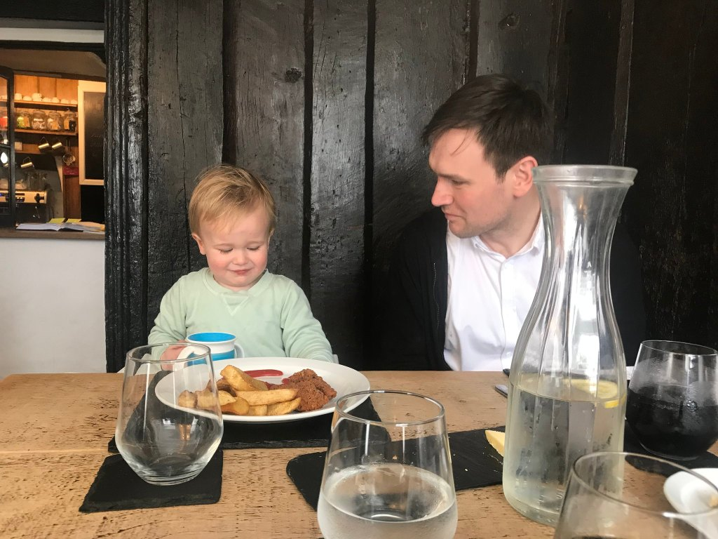 Dexter eating chips and nuggets sat next to Neil in a pub in abergavenny
