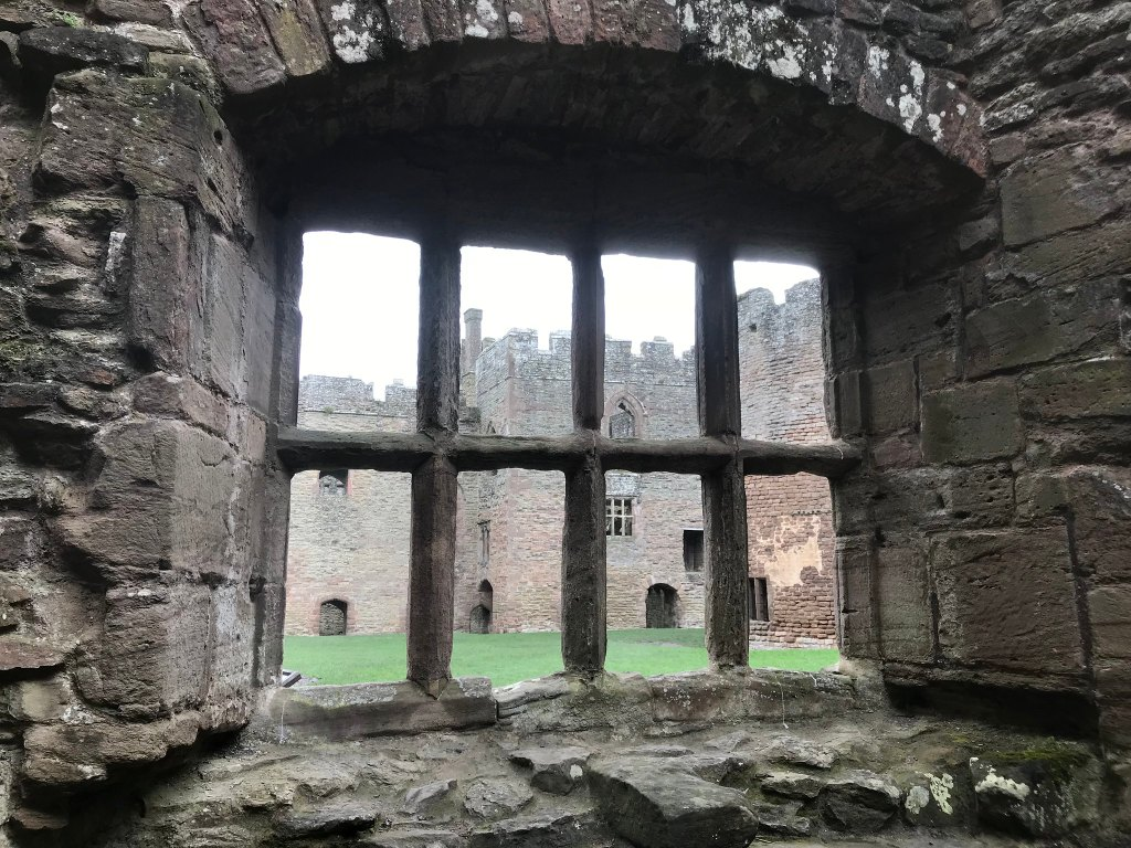 View through a ruined window to the other end of the castle at Ludlow castle