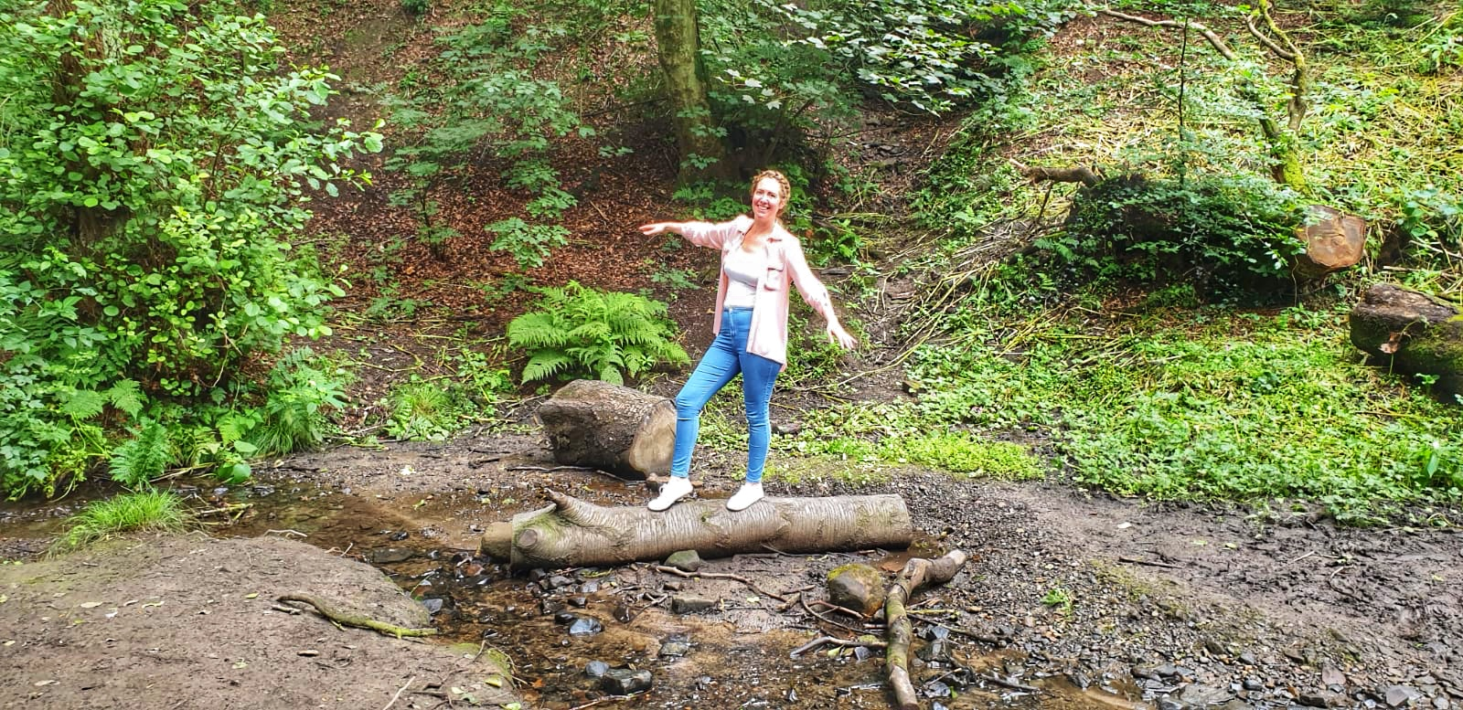 Nicola stood on a log in Fairy Glen in Parbold