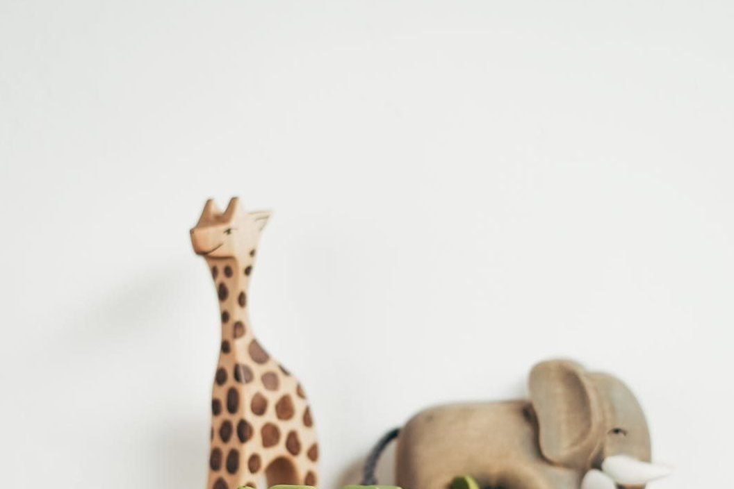 brown giraffe figurine on books