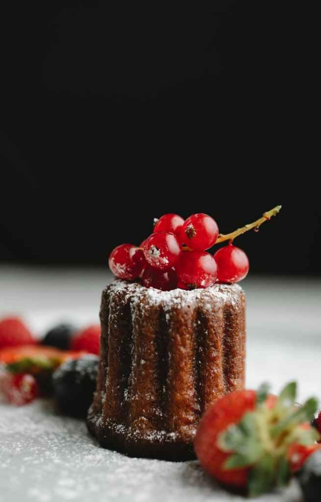 tasty cake on black background