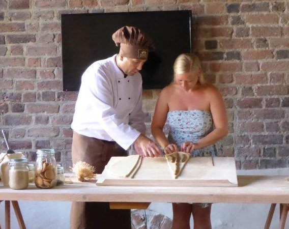 Making traditional St. Martin Croissant in Rogalowe museum in Poznan