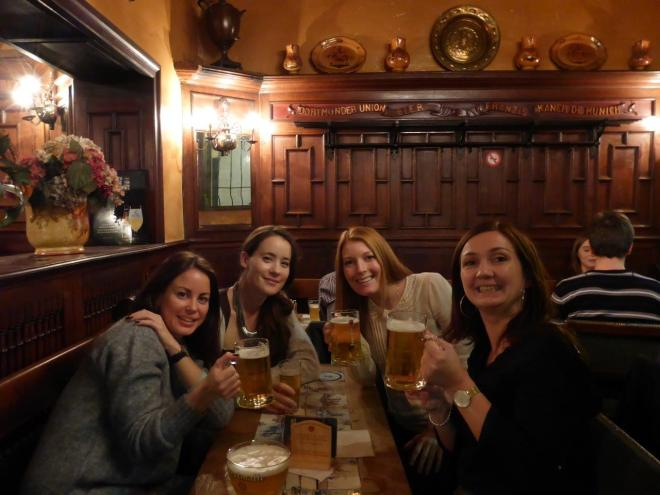 Happy beer drinkers in a cozy back alley bar in Brussels