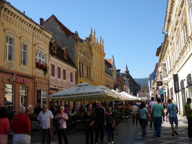 The main pedestrian street in Brasov old town, packed with restaurants