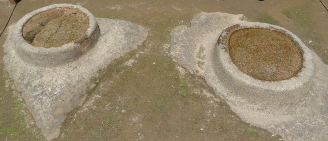 Two stones carved and filled with water; one reflecting the sun, the other the moon. Machu Picchu, Peru.