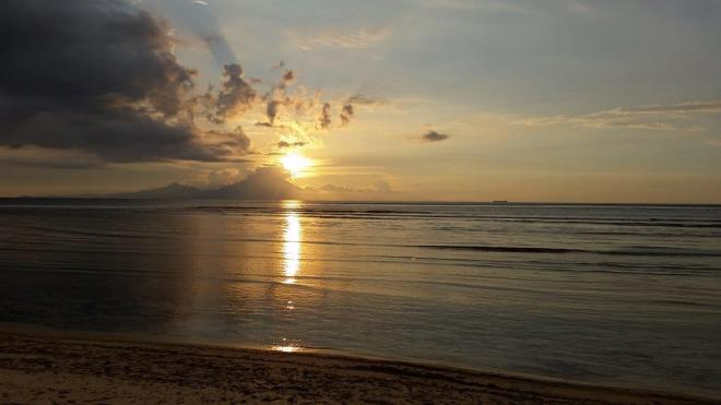 Sunset view towards Bali. Gili Trawangan, Indonesia