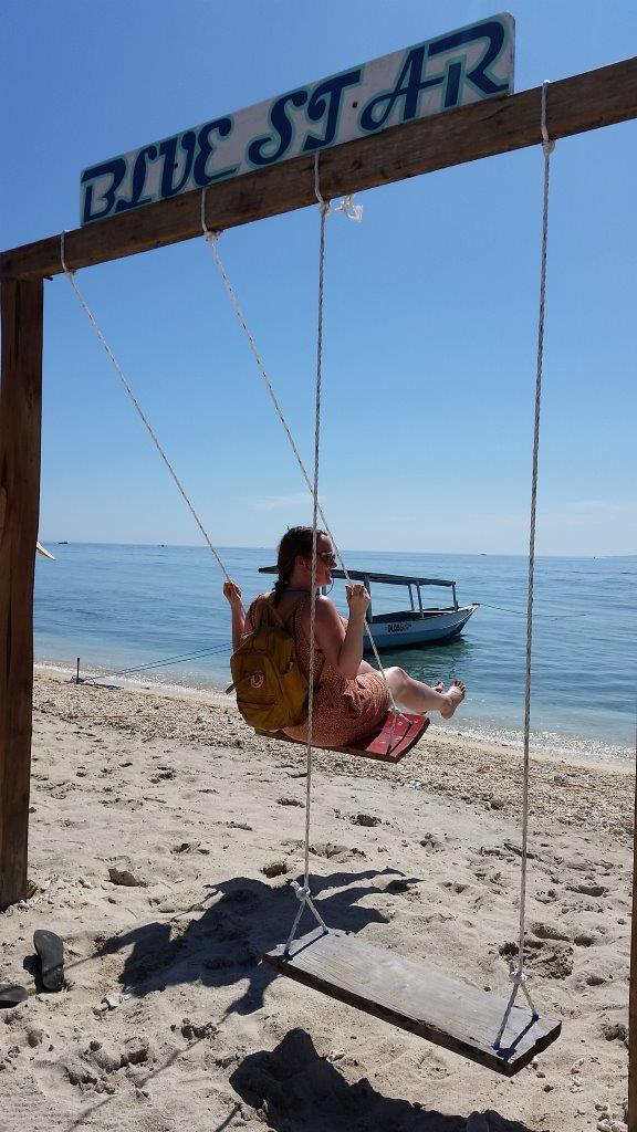 Taking a swing while exploring Gili Trawangan. Indonesia