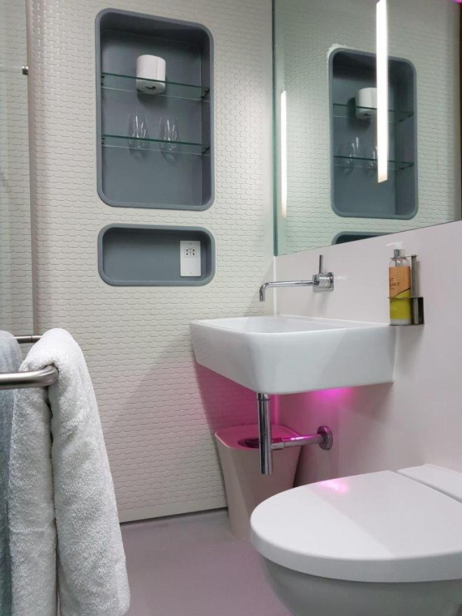 The bathroom in a Premium cabin at YOTELAIR at Amsterdam Airport Schiphol. There is also a monsoon rain shower.