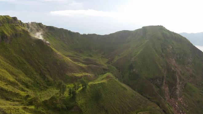 Green crater of Batur Volcano. Bali, Indonesia.