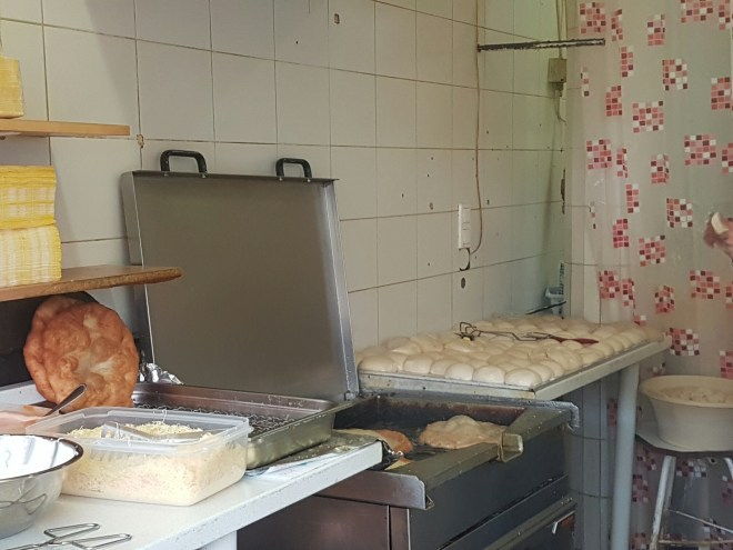 Langos in the making at the market in Buda. Taste Hungary food tour. Budapest, Hungary.