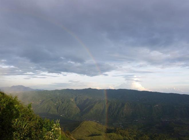 Rainbow over Batur Volcano. Bali, Indonesia.