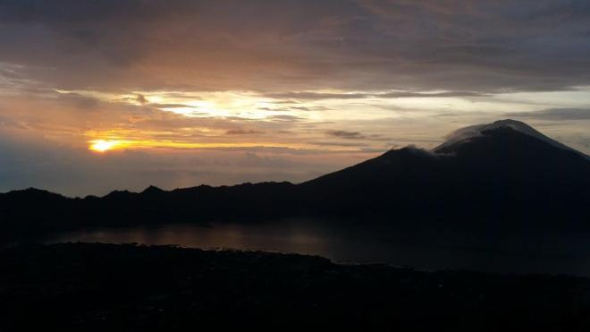 Watching the sunrise at Batur Volcano. Bali, Indonesia.