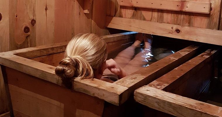 Soaking in a hot stone bath in Paro