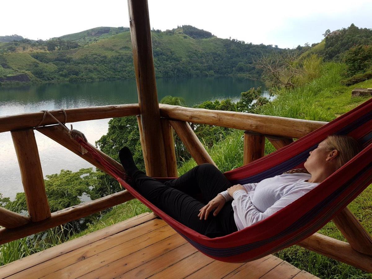 Power nap in the hammock at the terrace at Crater Safari Lodge by Kibale Forest National Park, Uganda.