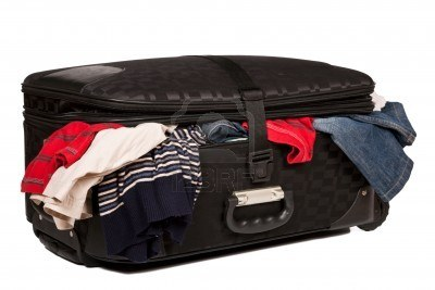3841254-overstuffed-baggage-in-old-suitcase-isolated-on-white-background