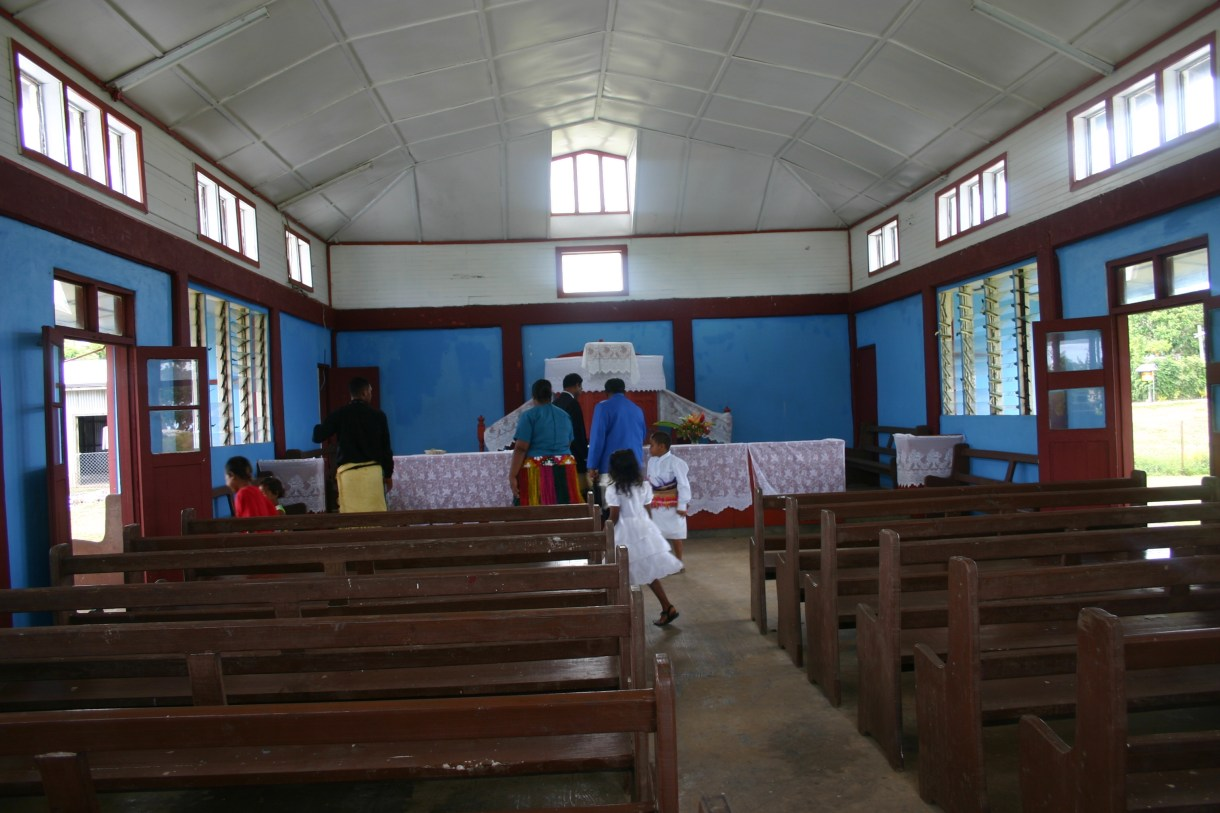 Congregation leaving Talihau Church, Tonga