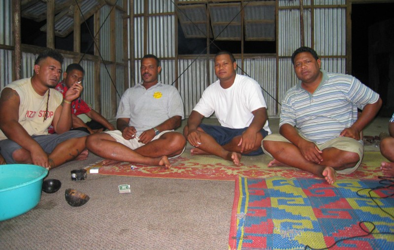Tongan men drinking somewhat intoxicating and traditional Kava in daily Kava Ceremony.