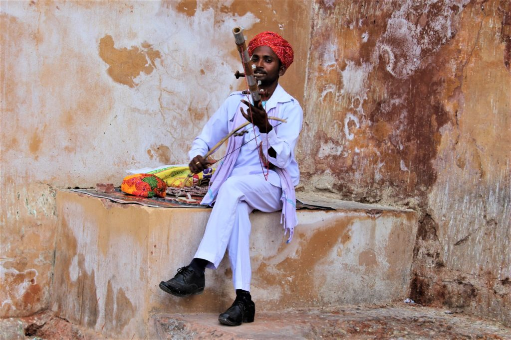 Things to do in Jaipur with Kids musician outside Amer Fort