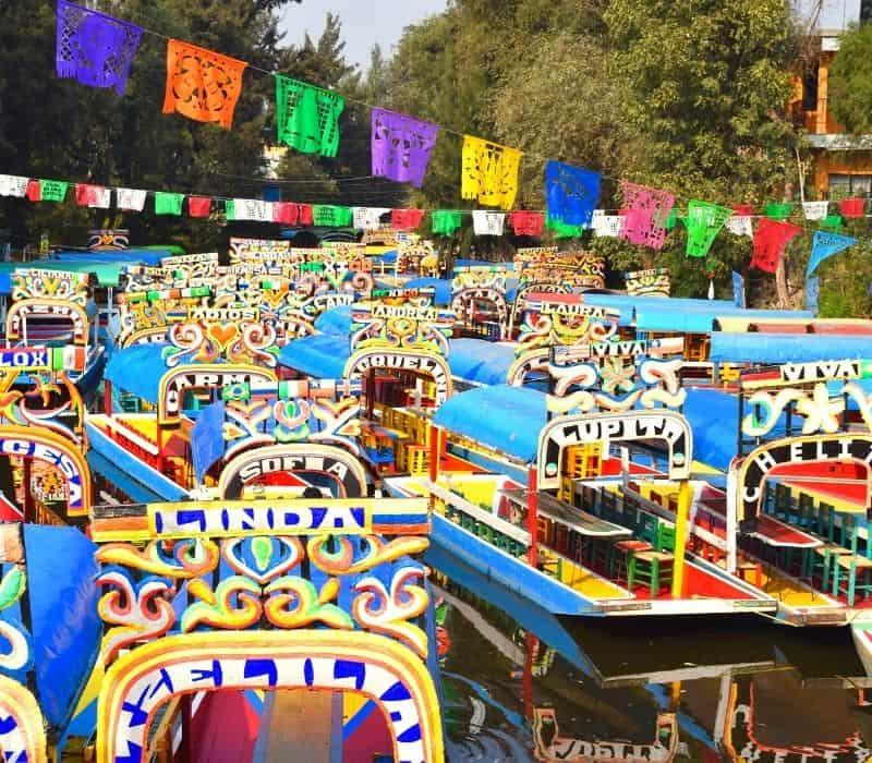 colorful trajineras, gondola-style boats, at Xochimilco.