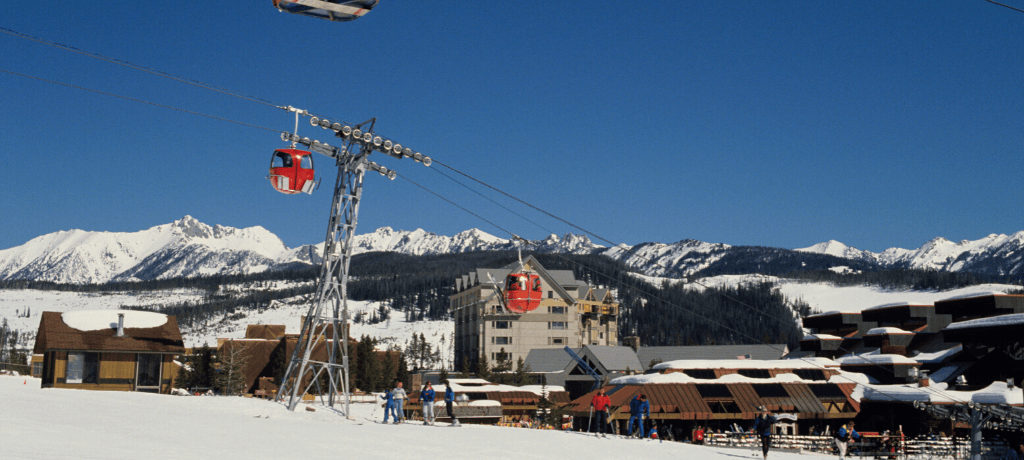Gondolas and skiers in Big Sky, Montana