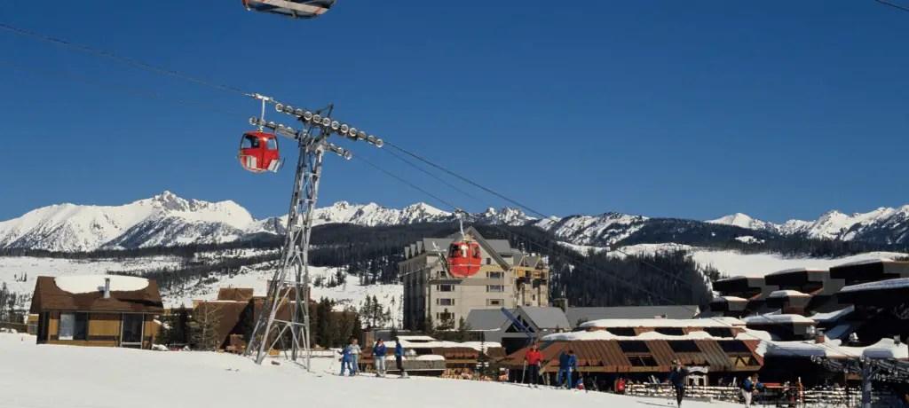 Gondolas and skiers in Big Sky, Montana