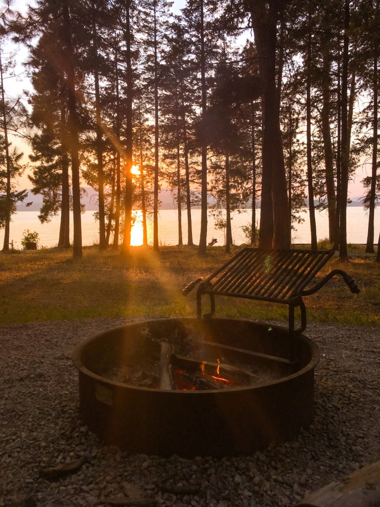 Sunset and lake view by the campfire at Finley Point Campground