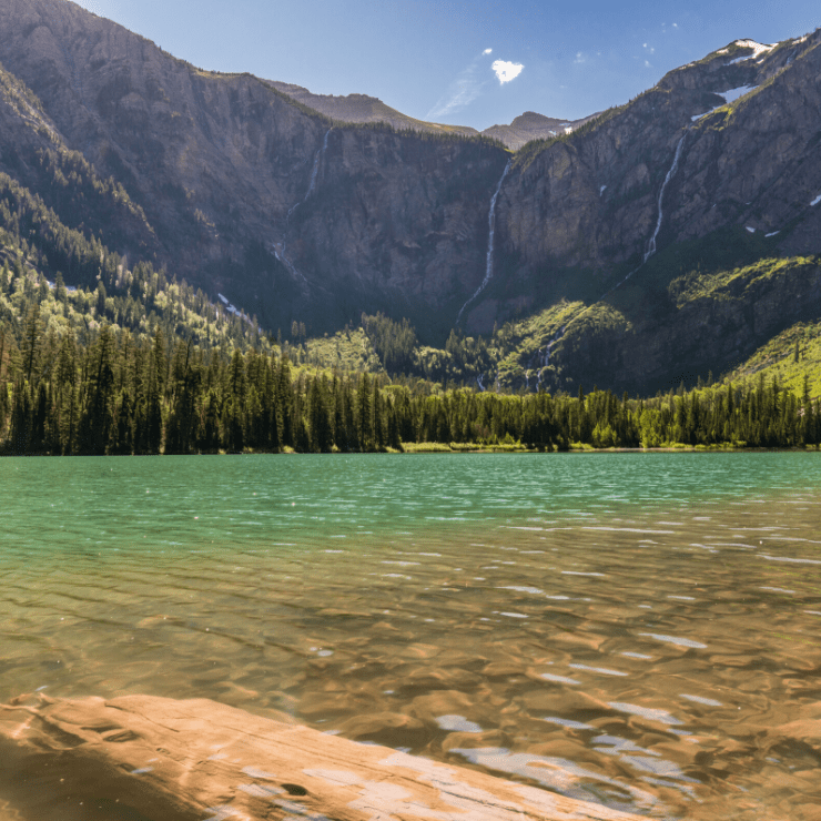 Clear glacial turquoise water in Avalanche Lake in Montana's Glacier National Park.