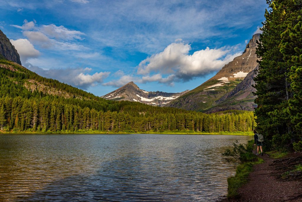 Hiking trail along Fishercap Lake in Glacier National Park, Montana