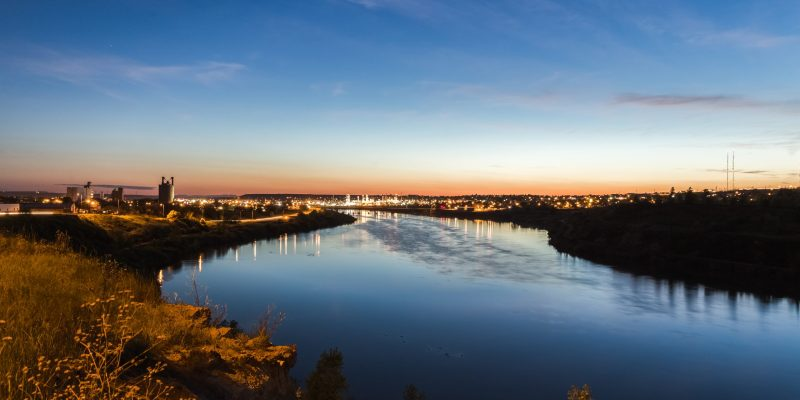 The skyline of Great Falls, Montana seen from the Missouri River that flows through the city.