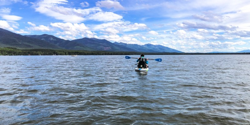 Swan Lake in Montana has many water activities you can do, including boating, paddle boarding, swimming, and kayaking.
