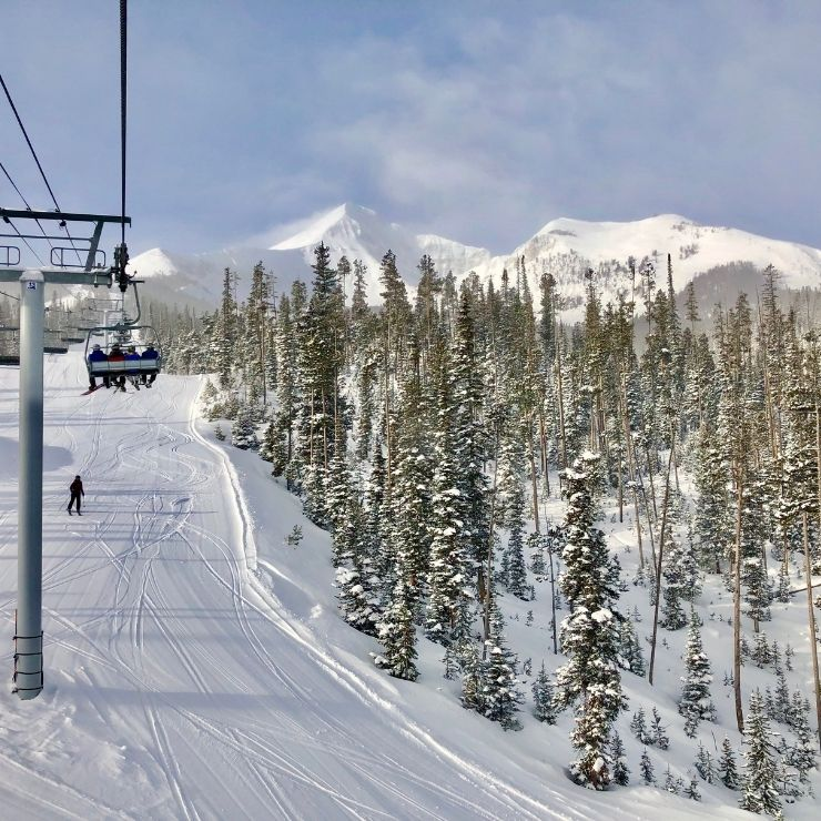 Big Sky Resort in Montana: skier and people on chairlift