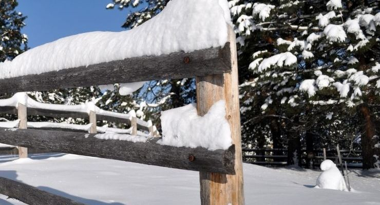 Snow fence in Montana that is the perfect backdrop for Christmas