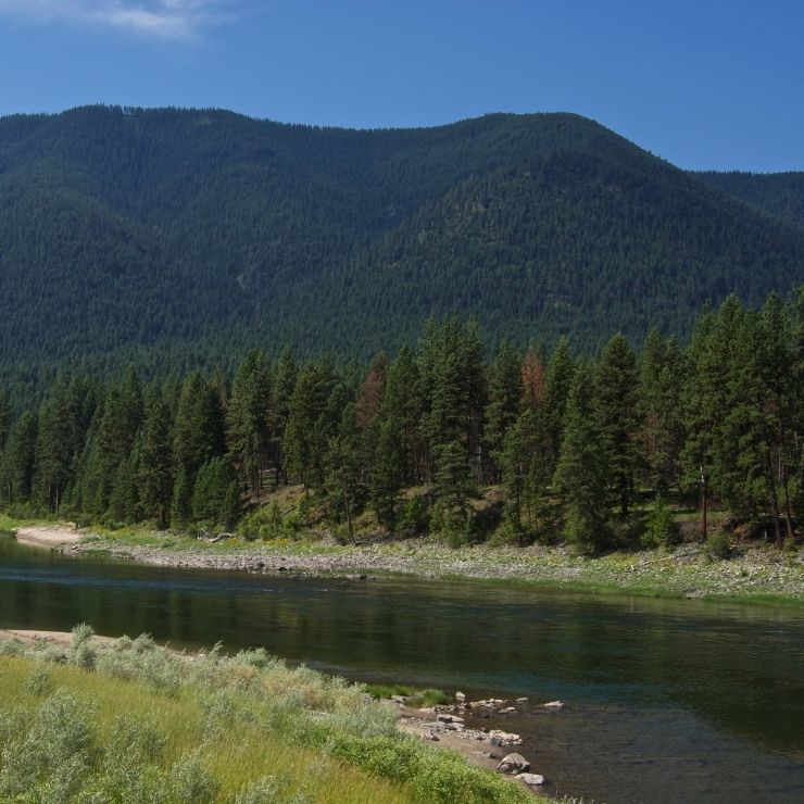 Winding river in Montana with mountains in background