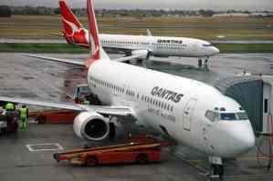 Qantas cuts international flights until October
