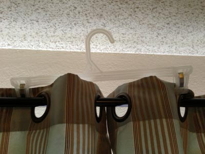 Clamp drapes together to avoid sunlight
