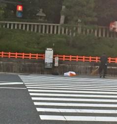 Street sweeper near temple