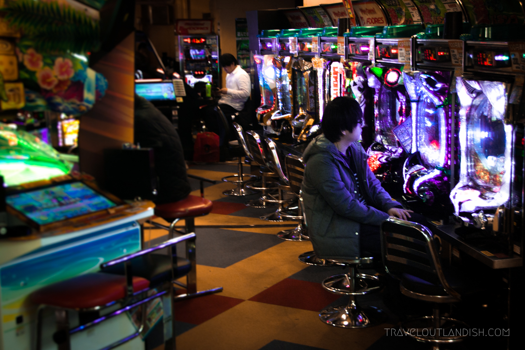Teenager playing arcade games